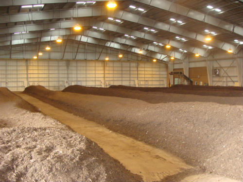 Photo of compost stored in large shed