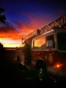Fire truck riding in the sunset