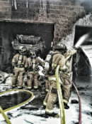 Fire Fighters using the fire hose