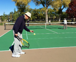 Photo of tennis players at Herb Martinez Park
