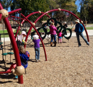 Photo of children and parents at Ft. Marcy Park play equipment
